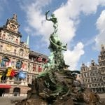 Antwerp market place with City Hall, houses and famous statue and fountain by Brabo