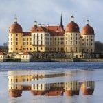 Moritzburg, Germany – January 04 2015: View of the Moritzburg Castle with reflection in lake at winter time