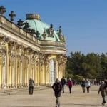 Potsdam, Germany – October 18, 2010: Unidentified people in front of Sanssouci Palace in Potsdam. Sanssouci Palace is former summer palace of Frederick the Great, King of Prussia, opened at 1747.