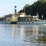 Pillnitz, Germany – July 12, 2011: Excursion steamer MS-Pillnitz on the Elbe near Dresden. Tourists on board the steamers admire the castle Pillnitz from the river side. The MS-Pillnitz is a paddle steamer built in 1886. The paddle steamer heard the Saxon Steamship Reederei GmbH & Co. KG, Conti Elbschiffahrts. In total there are 9 steamers in the Elbe Valley.
