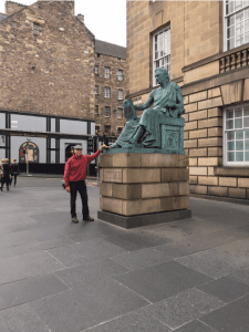 John poses with the monument to philosopher David Hume