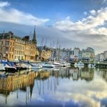 Day view of Honfleur's old port, with multicolored historic buildings facades