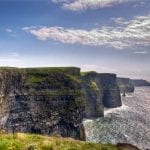walking very carefully along the edge of the Cliffs of Moher – Ireland