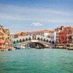 floating gracefully past the Rialto Bridge in Venice – Italy