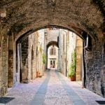 Arched medieval street in Assisi, Italy