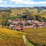 Small town of Barolo among hills and autumnal vineyards in Piedmont, Northern Italy